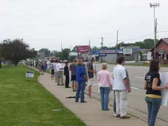 Participants in Life Line line up along War Memorial Drive in Peoria, Ill., on June 7 to pray for an end to abortion.